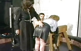 slave in leather petticoat is bow over by excited