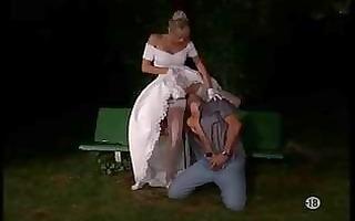 cute blond bride receives stuffed outdoor