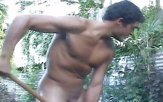 pumped up homosexual dude works in the garden
