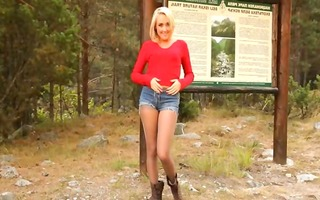 golden-haired chick in hose posing forest