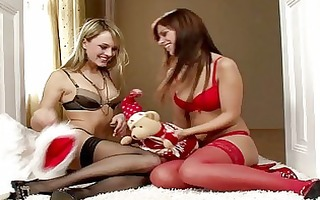 enchanting blonde and brunette lesbians giving a