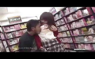 naughty oriental schoolgirl at the clip store