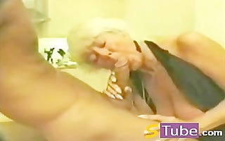 non-professional blond older engulfing her allies
