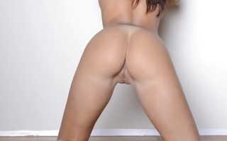 busty pornstar dancing by the wall