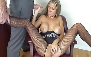 busty blonde secretary in fishnet nylons gives