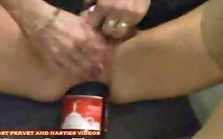 bizarre insertion the bottle of coke in the gazoo