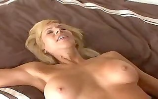 breasty mature cougar seduces a younger guy