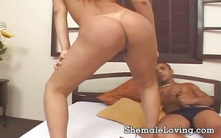 sexy t-girl rides her booty on a large cock